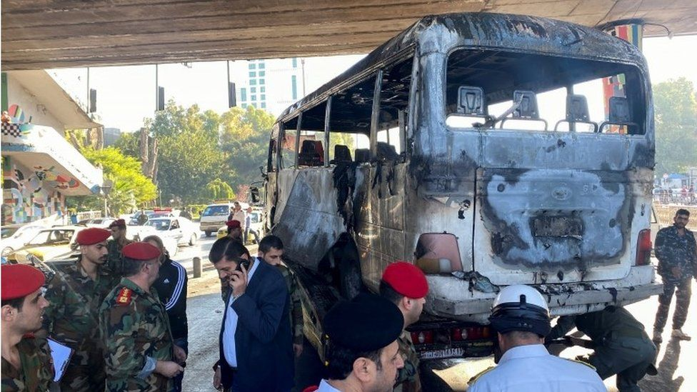 Deadly bomb blasts hit military bus in Damascus